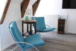 Coin salon avec télévision, chambre d'hôtes Aaisa