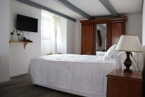Bedroom, in a guest-room in Besse in Auvergne, with king-size bed and television