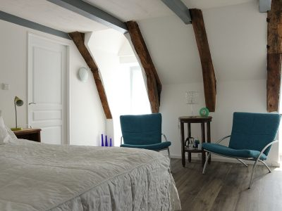 King-size bed in guest-room in Auvergne